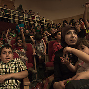 Children and mamas watching the Mobile Circus show in Hebron; In all the cities of the theaters are full, circus is an event and palestinians are proud to know that the show is made by young palestinians too.