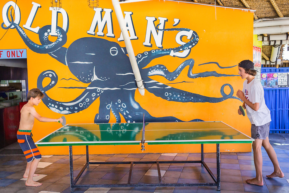 Patrons play ping-pong.