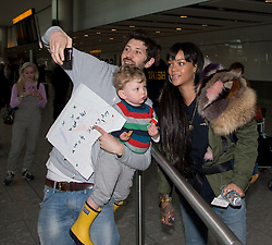 Rihanna has a 'Selfie' photograph with fans at Heathrow after she arrived from LA, Heathrow Airport, United Kingdom. Monday, 24th March 2014. Picture by David Dyson / i-Images