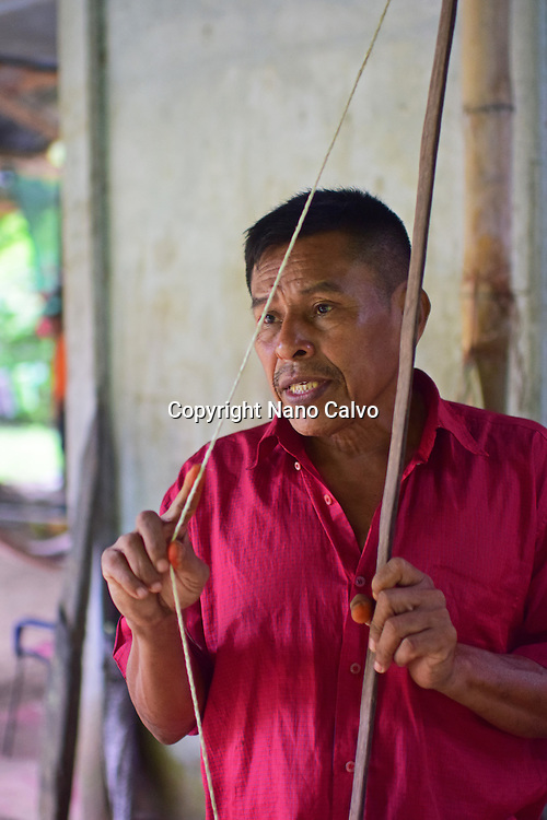Catato López, Bribri man holding handmade bow. A day with the Bribri, indigenous people in Limón Province of Costa Rica