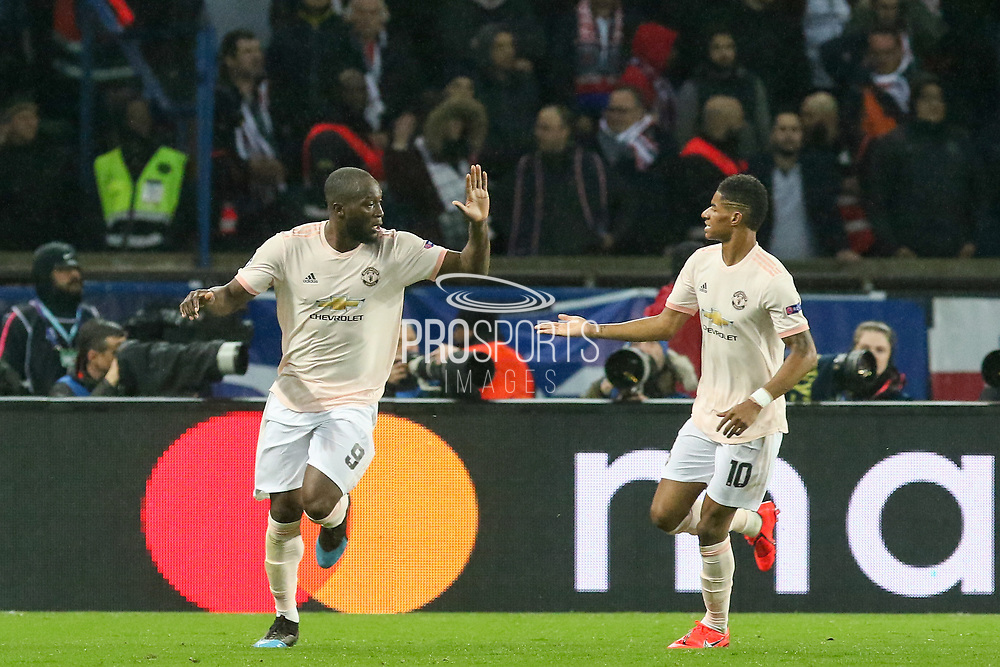 GOAL - Manchester United Forward Romelu Lukaku celebrates with Manchester United Forward Marcus Rashford 1-2 during the Champions League Round of 16 2nd leg match between Paris Saint-Germain and Manchester United at Parc des Princes, Paris, France on 6 March 2019.