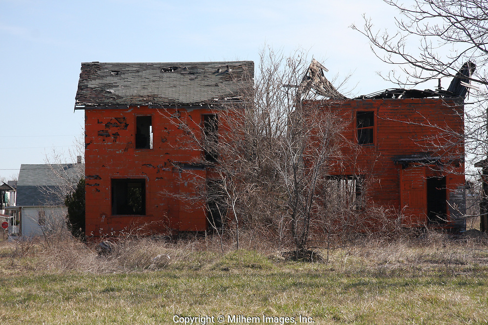 Detroit residential homes painted orange and ready to be demolished.
