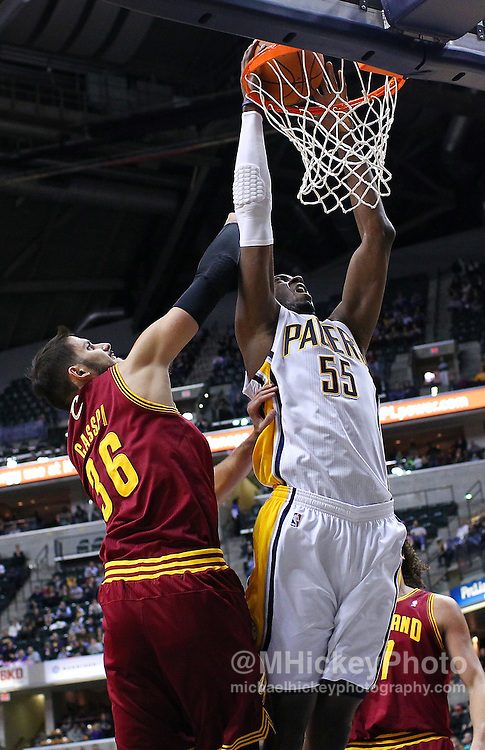 Dec. 30, 2011; Indianapolis, IN, USA; Indiana Pacers center Roy Hibbert (55) dunks the ball as Cleveland Cavaliers small forward Omri Casspi (36) defends from behind at Bankers Life Fieldshouse. Mandatory credit: Michael Hickey-US PRESSWIRE