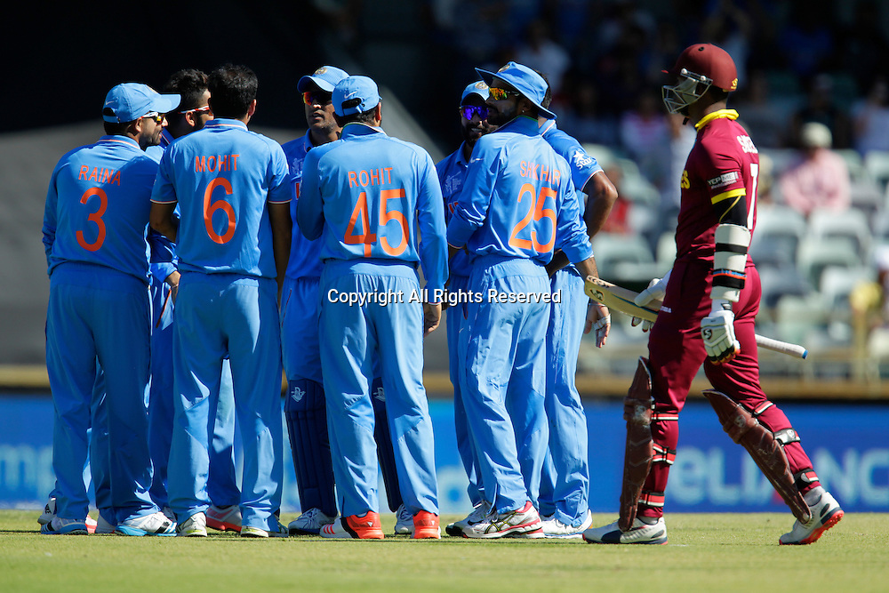 06.03.2015. Perth, Australia. ICC Cricket World Cup. India versus West Indies. Marlon Samuels walks past the celebrating Indian players after his dismissal.