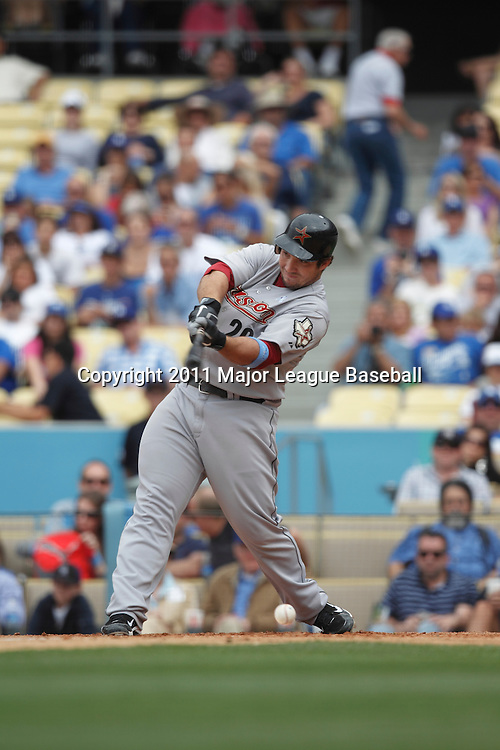 LOS ANGELES - JUNE 19:  Brett Wallace #29 of the Houston Astros takes a swing at a pitch during the game against the Los Angeles Dodgers at Dodger Stadium on Sunday, June 19, 2011 in Los Angeles, California.  The Dodgers defeated the Astros 1-0.  (Photo by Paul Spinelli/MLB Photos via Getty Images) *** Local Caption *** Brett Wallace