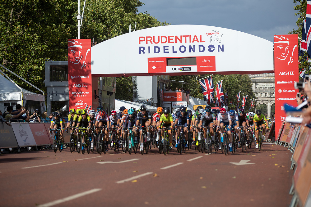 The riders cross the start line to begin racing in The Prudential RideLondon Classique. Saturday 28th July 2018<br /> <br /> Photo: Ian Walton for Prudential RideLondon<br /> <br /> Prudential RideLondon is the world's greatest festival of cycling, involving 100,000+ cyclists - from Olympic champions to a free family fun ride - riding in events over closed roads in London and Surrey over the weekend of 28th and 29th July 2018<br /> <br /> See www.PrudentialRideLondon.co.uk for more.<br /> <br /> For further information: media@londonmarathonevents.co.uk