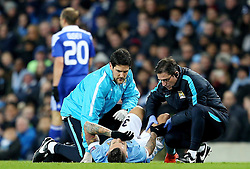Nicolas Otamendi of Manchester City receives treatment for a dead leg  - Mandatory byline: Matt McNulty/JMP - 15/03/2016 - FOOTBALL - Etihad Stadium - Manchester, England - Manchester City v Dynamo Kyiv - Champions League - Round of 16