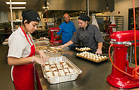 Julia Singh, Jack Aldrich and Katie Theberge pack up pumpkin bars and mini pumpkin cupcakes during Culinary Arts class at the Huot Technical Center on Thursday.  (Karen Bobotas/for the Laconia Daily Sun)