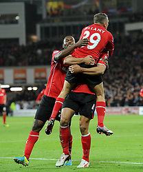 Cardiff City's Steven Caulker celebrates his winning goal with Cardiff City's Kevin Theophile Catherine and Cardiff City's Craig Bellamy - Photo mandatory by-line: Joe Meredith/JMP - Tel: Mobile: 07966 386802 03/11/2013 - SPORT - FOOTBALL - The Cardiff City Stadium - Cardiff - Cardiff City v Swansea City - Barclays Premier League