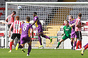 Liam Hearn scores Lincoln's goal during the Vanarama National League match between Lincoln City and Cheltenham Town at Sincil Bank, Lincoln, United Kingdom on 8 August 2015. Photo by Antony Thompson.