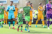 Forest Green Rovers Joseph Mills(23) and mascot during the EFL Sky Bet League 2 match between Forest Green Rovers and Newport County at the New Lawn, Forest Green, United Kingdom on 31 August 2019.