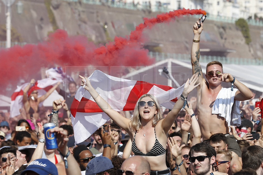 © Licensed to London News Pictures. 07/07/2018. Brighton, UK. Football fans react as they watch England V Sweden from the Russian World Cup on a giant TV screen on the sea front in Brighton. Photo credit: Peter Macdiarmid/LNP