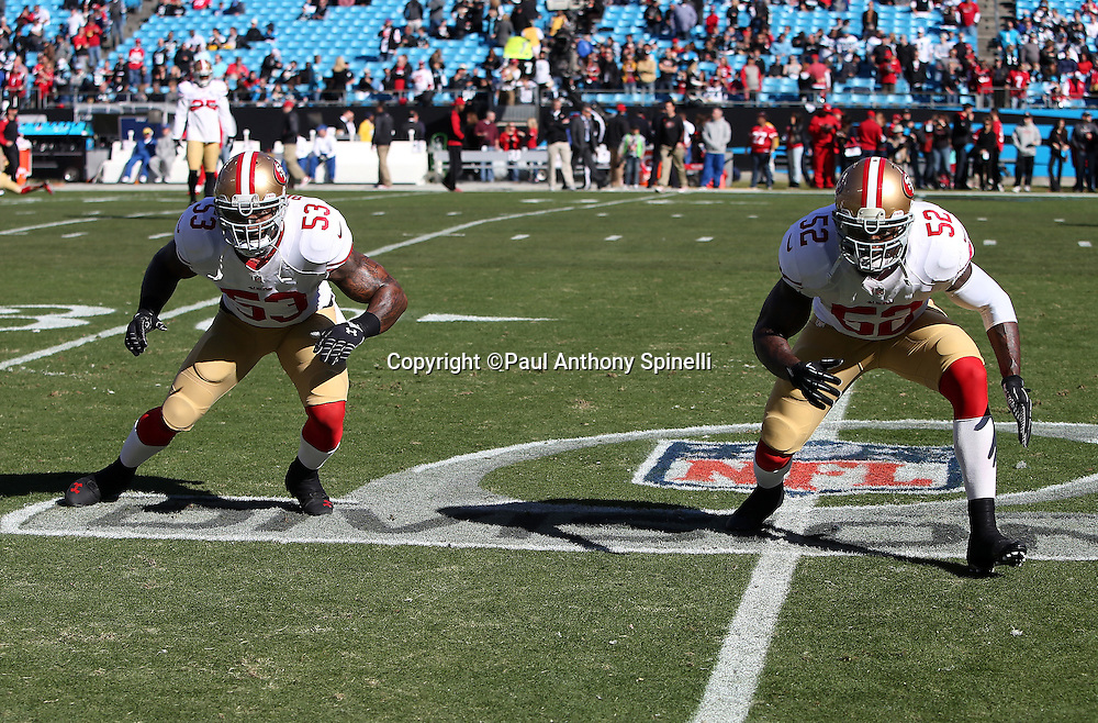 San Francisco 49ers inside linebacker NaVorro Bowman (53) and San Francisco 49ers inside linebacker Patrick Willis (52) are an imposing pair facing the opposition as they do a pregame drill together while on the divisional playoff game logo painted on the field for the NFC Divisional Playoff NFL football game against the Carolina Panthers on Sunday, Jan. 12, 2014 in Charlotte, N.C. The 49ers won the game 23-10. ©Paul Anthony Spinelli