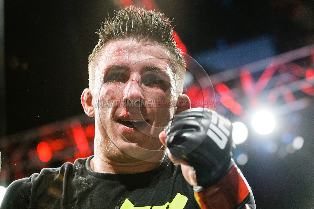 "MANCHESTER, ENGLAND, OCTOBER 26, 2013: Norman Parke celebrates his win during ""UFC Fight Night 30: Machida vs. Munoz"" inside Phones4U Arena in Manchester, England (© Martin McNeil)"