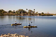 Kayakers traverse Roper Lake at Roper Lake State Park in Graham County, Safford, Arizona, USA.