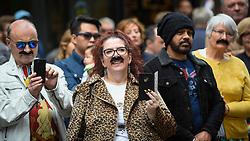 "© Licensed to London News Pictures. 05/09/2018. LONDON, UK.  Fans of Freddie Mercury and members of the public in Carnaby Street don moustaches during ""Freddie for a Day"", a fundraising event in aid of the Mercury Phoenix Trust on Freddie Mercury's birthday.  Queen tribute band ""Bulsara and the Queenies"" sang iconic songs entertaining crowds.  Photo credit: Stephen Chung/LNP"