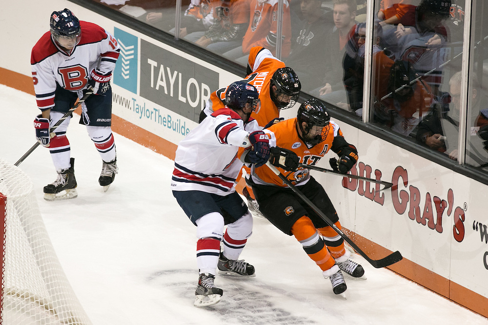 RIT Junior Captain Brad McGowan and Josh Mitchell put pressure on the Brock University defense during a game at the Gene Polisseni Center on Saturday, October 4, 2014.