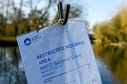 © Licensed to London News Pictures. 02/12/2019. WATFORD, UK. A sign indicates when access to the area will be restricted to the public ahead of the NATO Summit at The Grove Hotel Chandler's Cross, which will be attended by heads of state and government.  The main NATO leaders' meeting takes place on 4 December.  Donald Trump, President of the United States, who will be one of the leaders attending, will also be one of the guests at a reception at Buckingham Palace on 3 December.  Photo credit: Stephen Chung/LNP