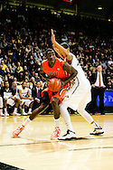 January 2nd, 2014:  Oregon State Beavers sophomore forward Daniel Gomis (14) attempts to take the ball past Colorado Buffaloes sophomore forward Josh Scott (40) in the first half of action in the NCAA Basketball game between the Oregon State Beavers and the University of Colorado Buffaloes at the Coors Events Center in Boulder, Colorado
