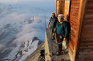 """Alpinists at Solvay hut.<br /> <br /> """"Matterhorn 150 years Cervino"""" - The year 2015 is the 150th Anniversary of the first ascent by Edward Whymper from the Swiss side (14th July) and by Jean Antoine Carrel from the Italian side on the 17th July 1865.<br /> On 17th July 2015 a friendship convention was signed by the members of Swiss, French, British and Italian climbing teams. A ceremony was held at the summit in honour of the mountain."""
