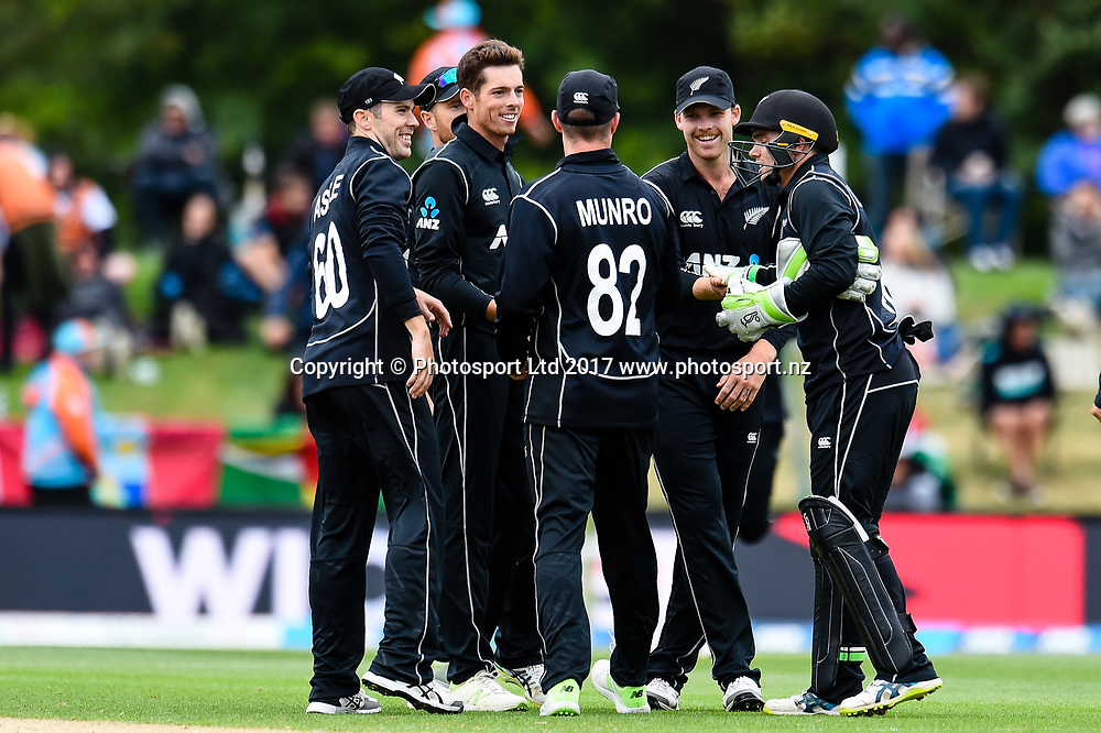 Mitchell Santner of the Black Caps celebrates his wicket with team mates during Third ODI Cricket  match, Blackcaps V West Indies, Hagley Oval, Christchurch, Christchurch, New Zealand, 26th December 2017.Copyright photo: John Davidson / www.photosport.nz