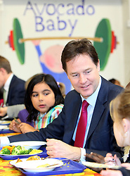 © Licenced to London News Pictures. 04/12/2013. London. UK.  <br /> Deputy Prime Minister Nick Clegg is pictured being served food in the school canteen with children during his and schools minister David Laws' visit to the Walnut Tree Walk Primary School in London, December 4th 2013. The Deputy Prime Minister announced in September that one of his key priorities for the Autumn Statement was to provide free school meals to every infant school pupil.<br /> Photo Credit: Susannah Ireland