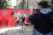 as fans celebrate outside the stadium and through the city before and during the Premier League match between Liverpool and Aston Villa at Anfield, Liverpool, England on 5 July 2020.