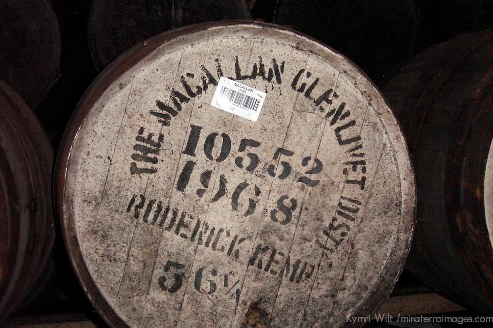 Europe, United Kingdom, Great Britain, Scotland. Macallan Glenlivet whiskey cask in a distillery warehouse.