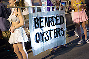 While many New Orleanians had already evacuated for Hurricane Katrina, the Bearded Oysters reveled in Mid-Summer Mardi Gras outside the Maple Leaf Bar on Oak Street.  August 27, 2005