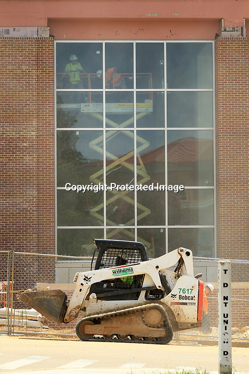 Construction crews work inside and out at the Student Union building on the University of Mississippi Campus on Monday afternoon in Oxford.