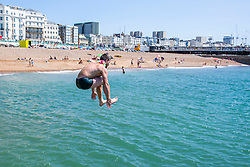 © Licensed to London News Pictures. 30/06/2016. Brighton, UK. A group of friend cool down in the sea as members of the public take advantage of the hot and sunny weather to spent time on the beach in Brighton and Hove.  Photo credit: Hugo Michiels/LNP