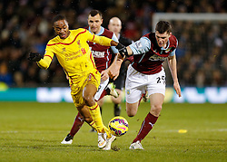 Raheem Sterling of Liverpool is challenged by Michael Keane of Burnley - Photo mandatory by-line: Rogan Thomson/JMP - 07966 386802 - 26/12/2014 - SPORT - FOOTBALL - Burnley, England - Turf Moor Stadium - Burnley v Liverpool - Boxing Day Christmas Football - Barclays Premier League.