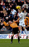 Photo: Leigh Quinnell.<br /> Wolverhampton Wanderers v Leeds United. Coca Cola Championship. 17/12/2005. Leeds' Matthew Kilgallon rises above Wolves' Kenny Miller.