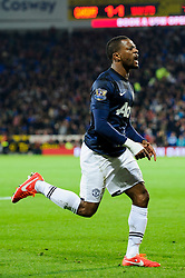 Man Utd Defender Patrice Evra (FRA) celebrates scoring a goal during the first half of the match - Photo mandatory by-line: Rogan Thomson/JMP - Tel: Mobile: 07966 386802 - 24/11/2013 - SPORT - FOOTBALL - Cardiff City Stadium - Cardiff City v Manchester United - Barclays Premier League.