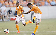 Jun 29, 2016; Houston, TX, USA; Houston Dynamo forward Mauro Manotas (19) shoots and scores on Sporting Kansas City in the second half at BBVA Compass Stadium. Dynamo won 3 to 1. Mandatory Credit: Thomas B. Shea-USA TODAY Sports