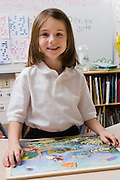 Little Girl with a Picture Puzzle
