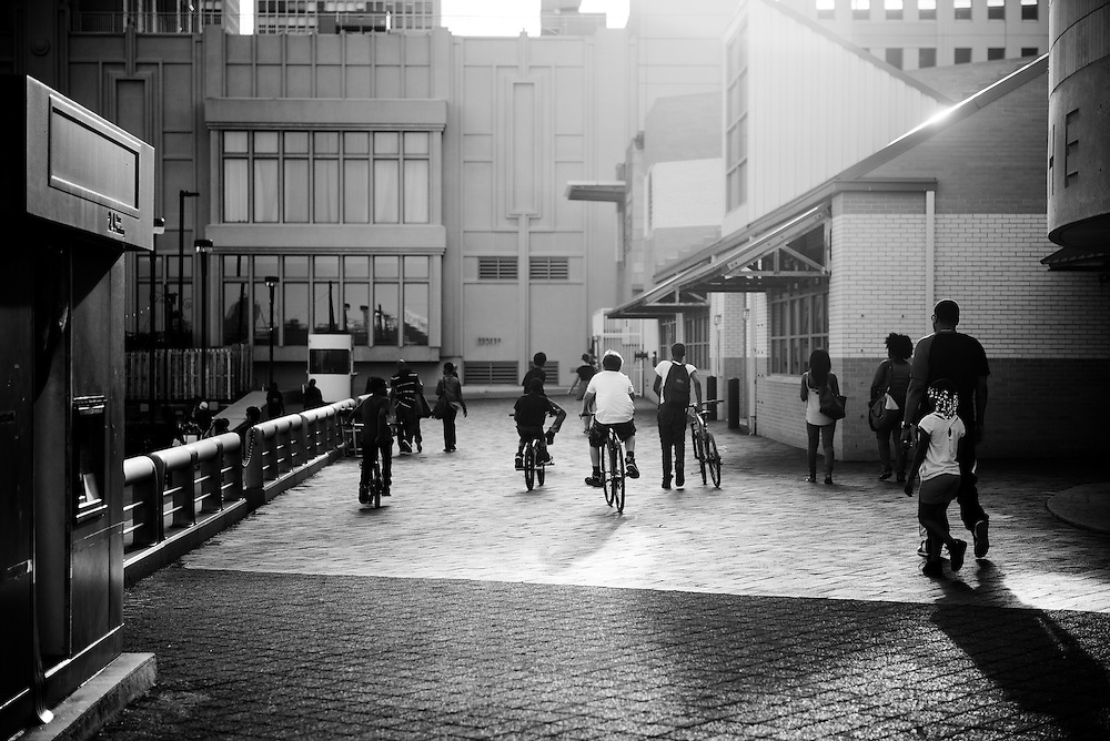 A group of boys ride their bikes through Penn's Landing.