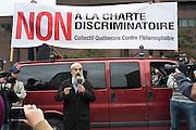 Montr&eacute;al, Canada, le 14 septembre 2013 des milliers de Qu&eacute;b&eacute;coisde communaut&eacute;s et de religions diff&eacute;rentes protestent contre l&rsquo;application de la Charte des valeurs qu&eacute;b&eacute;coises qui interdit aux employ&eacute;s de la fonction publique le port de signes religieux ostentatoires comme le hijab ou la Kippa.<br /> The 14th september 2013, in Montr&eacute;al Canada,  in the first mass action triggered by the proposal, thousands of protesters marched through downtown Montreal to call on the Parti Qu&eacute;b&eacute;cois government of Premier Pauline Marois to withdraw the charter.<br /> Salam Elmenyawi, president of the Muslim Council of Montreal, addresses protesters in Emilie Gamelin Square at the beginning of Montreal's first demonstration against the Parti Quebecois proposed Charter of Quebec Value.