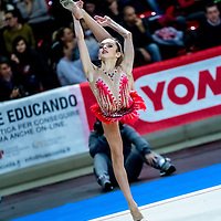 PADUA, ITALY - NOVEMBER 12 2016: Daria Gabbrielli of Raffaello Motto performs freehand at the italian national rhythmic gymnastic championship. Her score in the apparatus is 15,100. Her team's score is 96,650 and ended up in fourth position.<br /> #SerieAdiritmica<br /> #ginnasticaritmica #rhythmicgymnastic #gymnast #sport #sportphotography