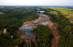 CANADA ALBERTA FORT MCMURRAY 10MAY07 - Aerial view of Boreal forest north of Fort McMurray, Alberta, Canada. The Alberta Tar Sands are the largest deposits of their kind in the world and their production is the single largest contributor to Canada's greenhouse gas emissions...Alberta's tar sands are currently estimated to contain a crude bitumen resource of 315 billion barrels, with remaining established reserves of almost 174 billion barrels, thus making Canada's oil resources ranked second largest in the world in terms of size...The industry has brought wealth and an economic boom to the region but also created an environmental disaster downstream from the Athabasca river, polluting the lakes where water and fish are contaminated. The native Indian tribes of the Mikisew, Cree, Dene and other smaller First Nations are seeing their natural habitat destroyed and are largely powerless to stop or slow down the rapid expansion of the oil sands development, Canada's number one economic driver...jre/Photo by Jiri Rezac / WWF-UK..© Jiri Rezac 2007..Contact: +44 (0) 7050 110 417.Mobile: +44 (0) 7801 337 683.Office: +44 (0) 20 8968 9635..Email: jiri@jirirezac.com.Web: www.jirirezac.com..© All images Jiri Rezac 2007 - All rights reserved.