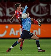 13-09-2008 VOETBAL:FC TWENTE:NEC NIJMEGEN:ENSCHEDE <br /> Arek Radomski wordt door Wout Brama hard verdedigd<br /> Foto: Geert van Erven