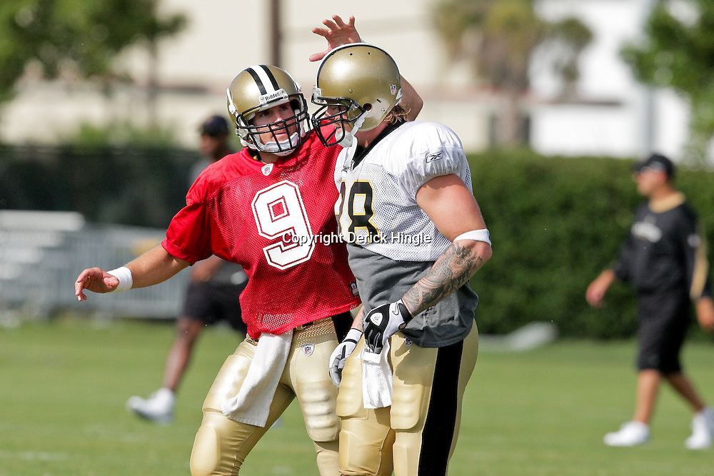 04 August 2009: New Orleans Saints quarterback Drew Brees (9) pats tight end Jeremy Shockey (88) on the helmet during New Orleans Saints training camp at the team's practice facility in Metairie, Louisiana.