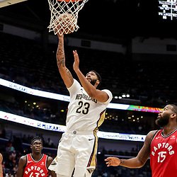Oct 11, 2018; New Orleans, LA, USA; New Orleans Pelicans forward Anthony Davis (23) shoots over Toronto Raptors center Greg Monroe (15) during the first half at the Smoothie King Center. Mandatory Credit: Derick E. Hingle-USA TODAY Sports