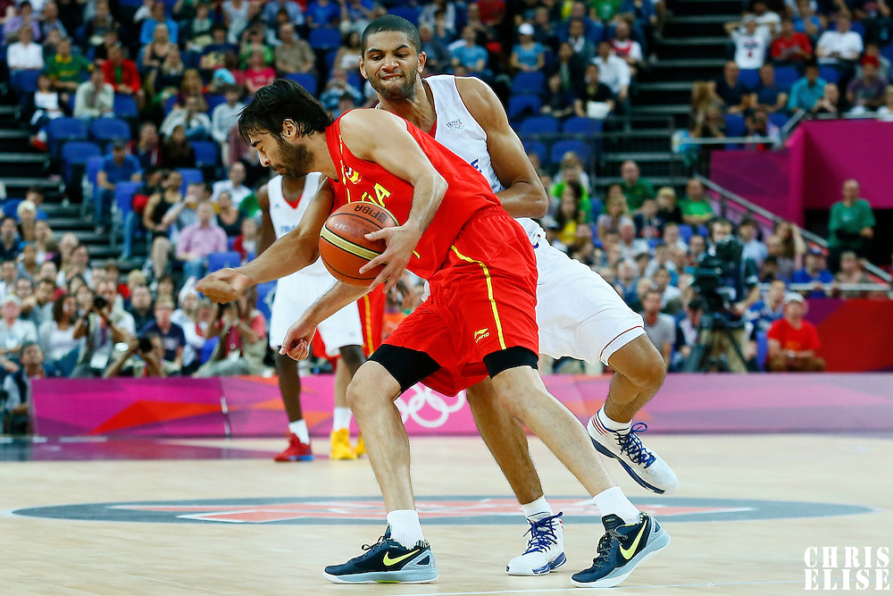 08 August 2012: France Nicolas Batum makes an hard foul on Spain Juan-Carlos Navarro during 66-59 Team Spain victory over Team France, during the men's basketball quarter-finals, at the 02 Arena, in London, Great Britain.