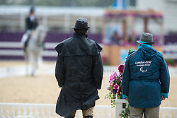 Officials endure the wind and rain during the Dressage competiton at the London 2012 Paralympic Games <br /> © Hippo Foto - Jon Stroud