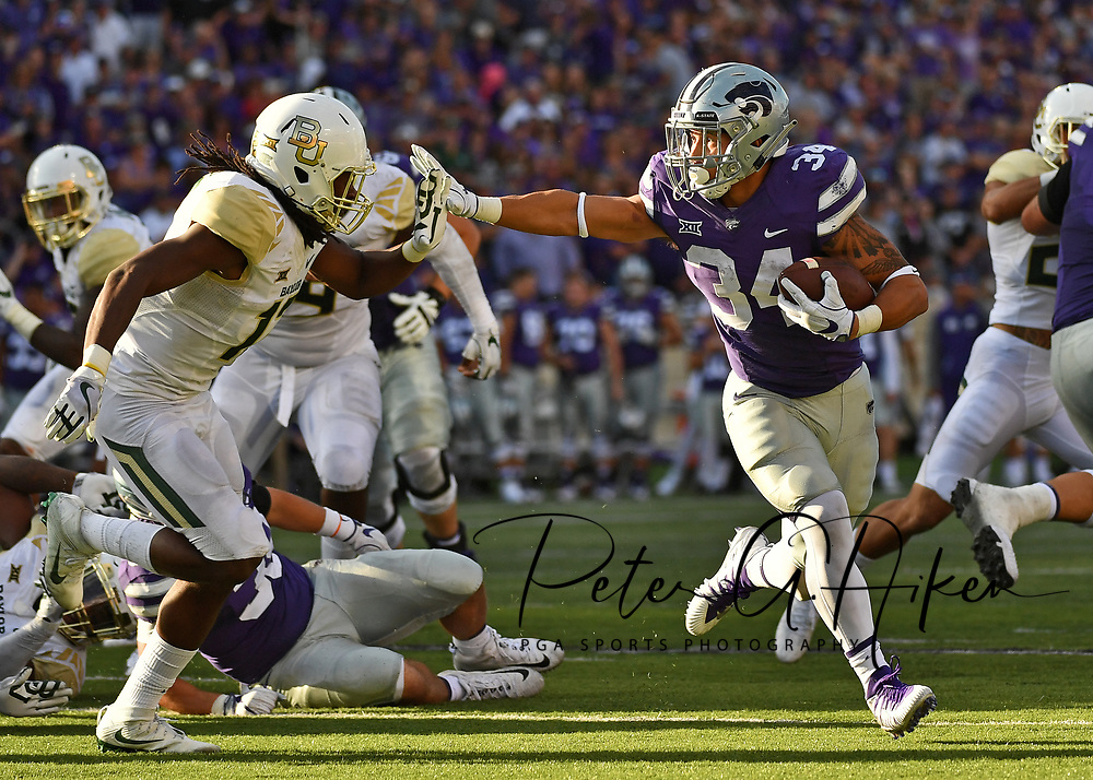 MANHATTAN, KS - SEPTEMBER 30:  Running back Alex Barnes #34 of the Kansas State Wildcats rushes up field against free safety Davion Hall #12 of the Baylor Bears during the second half on September 30, 2017 at Bill Snyder Family Stadium in Manhattan, Kansas.  (Photo by Peter G. Aiken/Getty Images) *** Local Caption *** Alex Barnes;Davion Hall