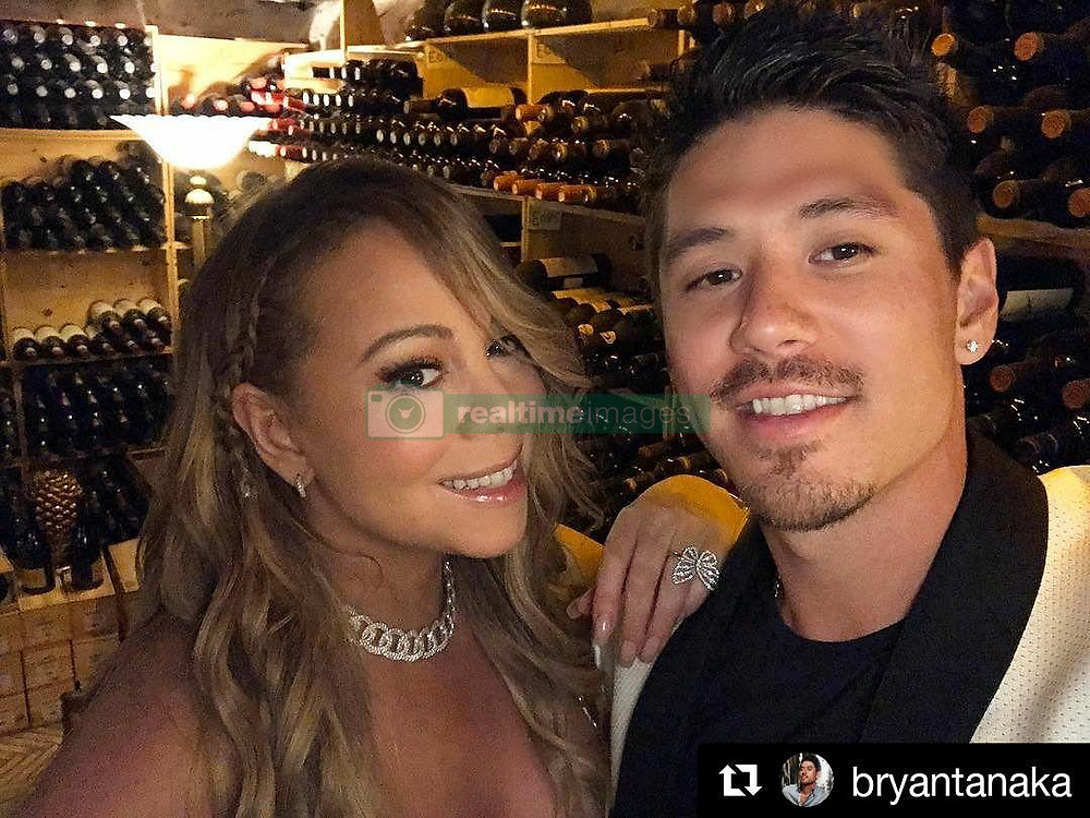"""Mariah Carey releases a photo on Instagram with the following caption: """"#Repost @bryantanaka (@get_repost)\n\u30fb\u30fb\u30fb\nWe're literally in a wine cellar that has over 250,000 bottles of wine, worth over 24 million dollars! \ud83d\udc40 It's one of the biggest collections of wine in the world!  The best part of this experience was spending it with this beautiful Queen. \ud83d\ude0e #BeautifulMemories #Moments4Life #MuchLove"""". Photo Credit: Instagram *** No USA Distribution *** For Editorial Use Only *** Not to be Published in Books or Photo Books ***  Please note: Fees charged by the agency are for the agency's services only, and do not, nor are they intended to, convey to the user any ownership of Copyright or License in the material. The agency does not claim any ownership including but not limited to Copyright or License in the attached material. By publishing this material you expressly agree to indemnify and to hold the agency and its directors, shareholders and employees harmless from any loss, claims, damages, demands, expenses (including legal fees), or any causes of action or allegation against the agency arising out of or connected in any way with publication of the material."""
