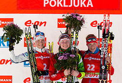 Second placed MAKARAINEN Kaisa of Finland, winner DOMRACHEVA Darya of Belarus and third placed ZAITSEVA Olga of Russia during flower ceremony after the Women 12.5 km Mass Start competition of the e.on IBU Biathlon World Cup on Sunday, March 9, 2014 in Pokljuka, Slovenia. Photo by Vid Ponikvar / Sportida