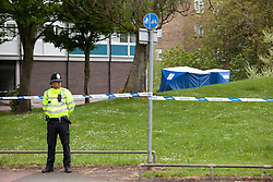 © Licensed to London News Pictures. 18/05/2013. Coventry, UK. Police on the scene of waste ground  in Coventry earlier today of a murderthat had taken  place in Upper Spon Street.  Photo credit : Dave Warren/LNP