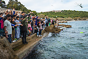 LESVOS, GREECE - NOV 6: Refugees throw flowers into the sea to commemorate the lives of the thousands of people who have drowned in the Aegean Sea trying to reach the safety of European shores in Mytilene on November 6th, 2016.